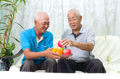 Healthy eating. Happy asian family eating healthy fruit Stock Photography