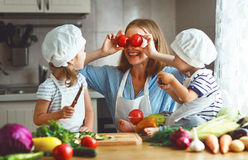 Healthy eating. Happy family mother and children prepares veget