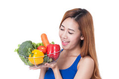 Healthy eating, happy young woman with vegetables stock image
