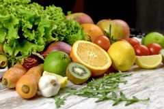 Healthy eating, healthy diet - organic fruit and vegetable. On rustic wooden table Royalty Free Stock Images