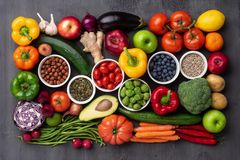 Healthy eating ingredients: fresh vegetables, fruits and superfood. Nutrition, diet, vegan food. Concrete background