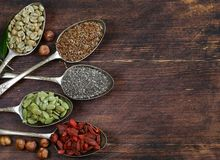 Healthy eating ingredients super food. Chia and flax seeds, goji berries, nuts stock images