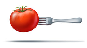 Healthy eating with a juicy red tomato and fork Stock Images