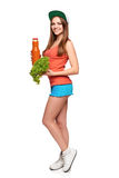 Healthy eating lifestyle. Happy teen girl holding a bottle of carrot juice and fresh lettuce standing in full length, over white background stock photography
