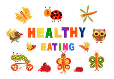 Healthy eating. Little funny vegetables around the word HEALTHY. EATING Stock Photos