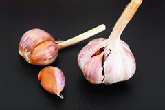 Healthy eating without meat: Break the garlic. Stock Photos