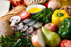 Healthy eating. Mediterranean diet. Fruit,vegetables, grain, nuts olive oil and fish. On wooden table stock photography
