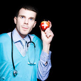 Healthy Eating Metaphor With Doctor Holding Apple Royalty Free Stock Photo