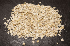 Healthy eating oat flakes closeup on a stone background Royalty Free Stock Images