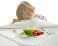 Healthy eating for a playful little girl Royalty Free Stock Images