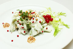 Healthy eating, salad with cucumbers and nuts Stock Photography