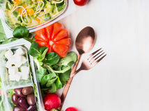 Healthy eating with salad and cutlery on white wooden background, top view. Clean and dieting food Royalty Free Stock Photo