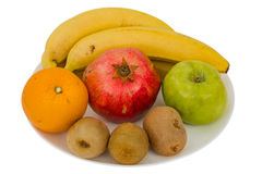 Healthy Eating. Seasonal organic raw fruit, isolated on white background Stock Photography