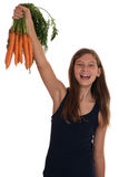 Healthy eating smiling girl with carrots Stock Photography