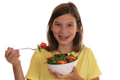 Healthy eating smiling girl with fresh salad Stock Images