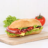 Healthy eating sub deli sandwich baguette with salami ham for br Royalty Free Stock Image