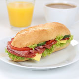Healthy eating sub sandwich baguette for breakfast with salami h Stock Photos