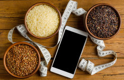 Healthy Eating, three kinds of rice: black, red and white on a w Stock Photography