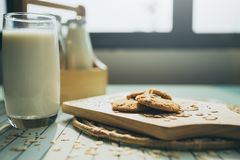 Healthy eating and traditional bakery concept. Fresh bread on the kitchen table with beverage at morning stock images
