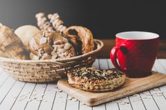 Healthy eating and traditional bakery concept;. Fresh bread on the kitchen table with beverage at morning stock photo