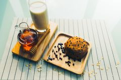 Healthy eating and traditional bakery concept. Fresh bread on the kitchen table with beverage at morning stock image
