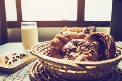 Healthy eating and traditional bakery concept. Fresh bread on the kitchen table with beverage at morning royalty free stock photos