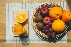 Healthy eating and traditional bakery concept. Top view of healthy eating and traditional breakfast concept; fresh orange juice on the kitchen table with fruits royalty free stock images