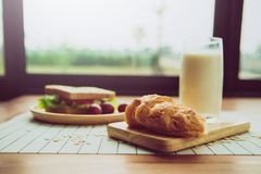 Healthy eating and traditional breakfast concept;. Fresh sandwich on the kitchen table with beverage at morning royalty free stock images