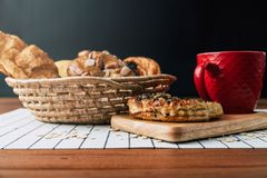 Healthy eating and traditional breakfast concept;. Healthy eating and traditional bakery concept; fresh bread on the kitchen table with beverage at morning royalty free stock images