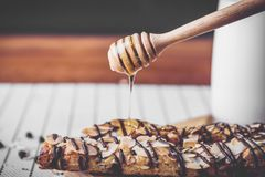Healthy eating and traditional breakfast concept;. Healthy eating and traditional bakery concept; fresh bread on the kitchen table with beverage at morning stock photography