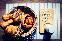 Healthy eating and traditional breakfast concept;. Top view of healthy eating and traditional bakery concept; fresh bread on the kitchen table with beverage at stock image