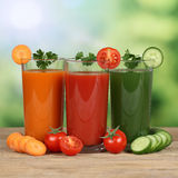 Healthy eating vegetable juice from carrots, tomatoes and cucumb Royalty Free Stock Photography
