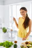 Healthy Eating. Vegetarian Woman Preparing Green Detox Juice. Di Royalty Free Stock Images