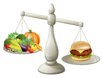 Healthy eating will power concept. Healthy food on one side of scales and fast food burger on the other. Burger is weighing more Stock Image