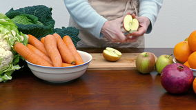 Healthy eating. A woman cuts a apple stock video
