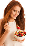 Healthy eating  - woman eats a bowl of fruit salad isolated over. White background - vegetarian meal Royalty Free Stock Photos
