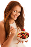 Healthy eating  - woman eats a bowl of fruit salad isolated over Stock Photography