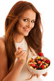 Healthy eating  - woman eats a bowl of fruit salad isolated over Stock Photo