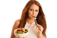 Healthy eating  - woman eats a bowl of greek salad isolated over. White background - vegetarian meal Royalty Free Stock Image
