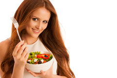 Healthy eating  - woman eats a bowl of greek salad isolated over. White background - vegetarian meal Stock Photos