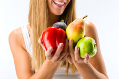 Healthy eating, woman with fruits and vegetables. Healthy eating, happy woman with fruits and vegetables royalty free stock photos