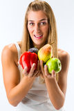 Healthy eating, woman with fruits and vegetables. Healthy eating, happy woman with fruits and vegetables Stock Photography