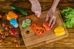 Healthy eating. Woman in kitchen at home preparing fresh salad Royalty Free Stock Photography