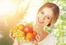 Healthy Eating. a woman with a plate of fruit in summer on natur Stock Images