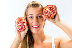 Healthy eating - woman with pomegranate. Smiling Royalty Free Stock Photography
