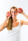 Healthy eating - woman with pomegranate Stock Photography