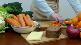 Healthy eating. A woman prepares a sandwich stock video