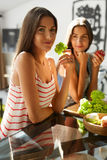 Healthy Eating Women Cooking Salad In Kitchen. Fitness Diet Food Stock Photography