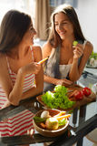 Healthy Eating Women Cooking Salad In Kitchen. Fitness Diet Food Stock Photos
