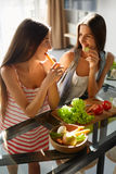 Healthy Eating Women Cooking Salad In Kitchen. Fitness Diet Food Royalty Free Stock Photo